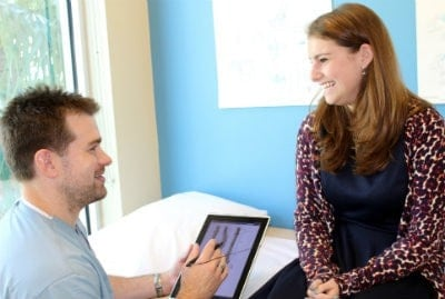 Dr. Matthew R. Willey (left) discusses treatment options with a patient.