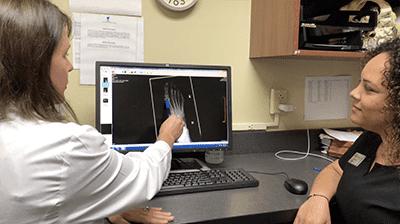 Dr. Davis explains flat foot reconstruction with a patient.