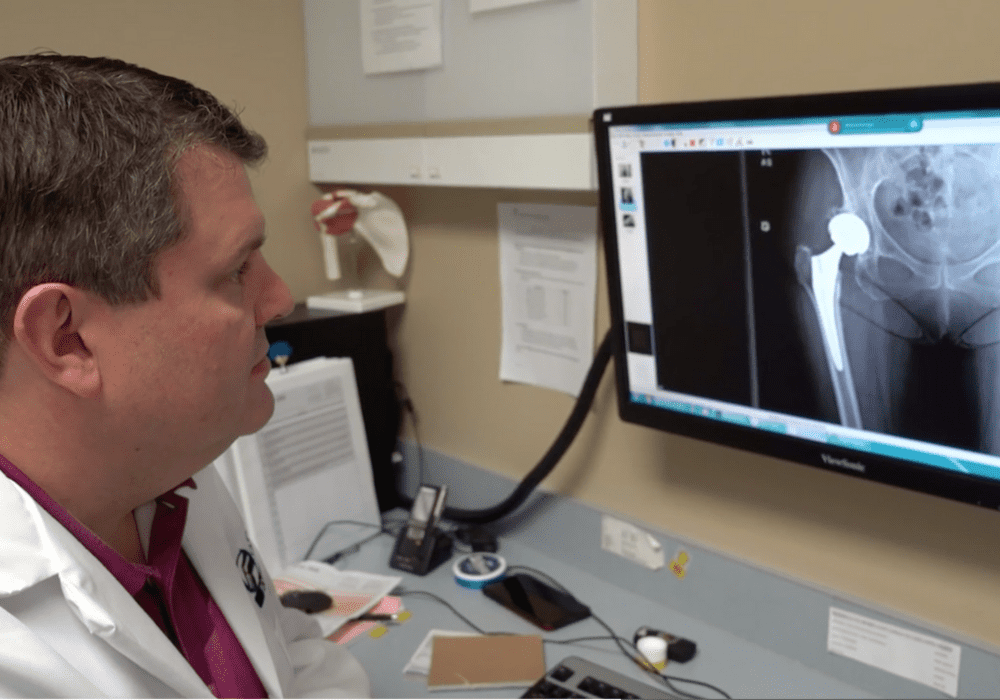 Specialist reviews x-ray for Anterior Approach Total Hip Replacement